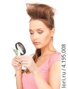Купить «Девушка внимательно изучает денежную купюру под лупой», фото № 4195008, снято 14 марта 2010 г. (c) Syda Productions / Фотобанк Лори