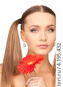 Купить «Привлекательная молодая женщина с длинными волосами с нежным цветком в руке», фото № 4195432, снято 6 июня 2010 г. (c) Syda Productions / Фотобанк Лори