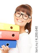 Купить «Веселая молодая офисная сотрудница с папками документах в руках на белом фоне», фото № 4200640, снято 27 июня 2010 г. (c) Syda Productions / Фотобанк Лори