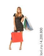 Купить «Счастливая девушка с многочисленными пакетами после шоппинга на белом фоне», фото № 4200800, снято 14 августа 2010 г. (c) Syda Productions / Фотобанк Лори