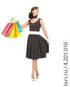 Купить «Счастливая девушка с многочисленными пакетами после шоппинга на белом фоне», фото № 4201016, снято 21 августа 2010 г. (c) Syda Productions / Фотобанк Лори
