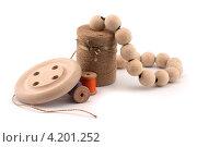 Бусы и деревянные пуговицы. Стоковое фото, фотограф Евгений Заржицкий / Фотобанк Лори