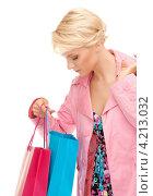 Купить «Счастливая покупательница с разноцветными пакетами на белом фоне», фото № 4213032, снято 24 июля 2010 г. (c) Syda Productions / Фотобанк Лори