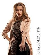 Купить «Молодая женщина в плаще на белом фоне», фото № 4213116, снято 10 октября 2010 г. (c) Syda Productions / Фотобанк Лори