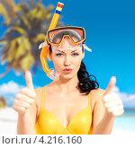Купить «Счастливая молодая женщина на пляже в купальнике и маске для ныряния поднимает большие пальцы вверх в знак одобрения», фото № 4216160, снято 12 января 2013 г. (c) Валуа Виталий / Фотобанк Лори