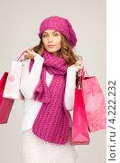Купить «Счастливая молодая женщина держит в руках покупки в бумажных пакетах на белом фоне», фото № 4222232, снято 10 октября 2010 г. (c) Syda Productions / Фотобанк Лори