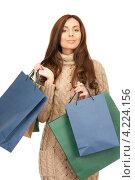 Купить «Счастливая покупательница с пакетами в руках после прогулки по магазинам», фото № 4224156, снято 6 ноября 2010 г. (c) Syda Productions / Фотобанк Лори
