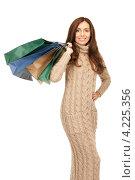 Купить «Привлекательная молодая женщина возвращается из магазина с покупками в пакетах», фото № 4225356, снято 6 ноября 2010 г. (c) Syda Productions / Фотобанк Лори