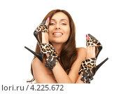 Купить «Счастливая женщина держит пару леопардовых туфель на каблуке в руках», фото № 4225672, снято 6 ноября 2010 г. (c) Syda Productions / Фотобанк Лори