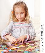 Купить «Девочка собирает пазлы», фото № 4228324, снято 15 января 2012 г. (c) Гладских Татьяна / Фотобанк Лори