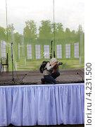 Фотограф на сцене (2012 год). Редакционное фото, фотограф Илья Матвеев / Фотобанк Лори