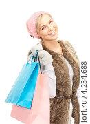 Купить «Привлекательная блондинка в зимней одежде с пакетами покупок в руках», фото № 4234688, снято 30 октября 2010 г. (c) Syda Productions / Фотобанк Лори