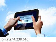 Купить «Мужские руки вводят имя и пароль электронной почты на планшетном компьютере на фоне неба с облаками», фото № 4238616, снято 5 ноября 2012 г. (c) Sergey Nivens / Фотобанк Лори