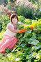Красивая женщина у грядки с огурцами, фото № 4246120, снято 25 марта 2015 г. (c) Майя Крученкова / Фотобанк Лори