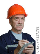Купить «Строгий подрядчик на стройке», фото № 4257788, снято 31 января 2013 г. (c) Владимир Вдовиченко / Фотобанк Лори