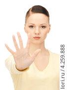 Купить «Расстроенная девушка останавливает что-то рукой», фото № 4259888, снято 2 октября 2010 г. (c) Syda Productions / Фотобанк Лори