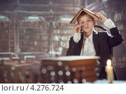 Школьник в библиотеке. Стоковое фото, фотограф Виктор Водолазький / Фотобанк Лори