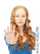 Купить «Молодая женщина показывает жест стоп», фото № 4282780, снято 27 ноября 2010 г. (c) Syda Productions / Фотобанк Лори