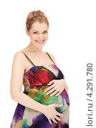 Купить «Молодая беременная женщина с длинными русыми волосами в сарафане на белом фоне», фото № 4291780, снято 12 марта 2011 г. (c) Syda Productions / Фотобанк Лори