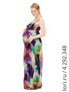 Купить «Молодая беременная женщина с длинными русыми волосами в сарафане на белом фоне», фото № 4292348, снято 12 марта 2011 г. (c) Syda Productions / Фотобанк Лори