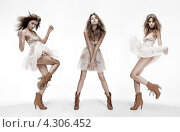Купить «Три юные девушки в легких юбках на белом фоне», фото № 4306452, снято 25 июня 2011 г. (c) Syda Productions / Фотобанк Лори