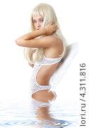 Купить «Девушка в белом белье с крыльями», фото № 4311816, снято 14 августа 2006 г. (c) Syda Productions / Фотобанк Лори