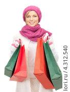 Купить «Восторженная девушка с покупками в пакетах улыбается на белом фоне», фото № 4312540, снято 10 апреля 2020 г. (c) Syda Productions / Фотобанк Лори
