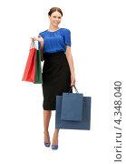 Купить «Красивая девушка на белом фоне держит в руках пакеты с покупками», фото № 4348040, снято 2 апреля 2011 г. (c) Syda Productions / Фотобанк Лори