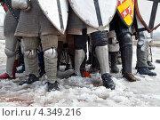 Купить «Историческая реконструкция. Ноги воинов со щитами перед битвой на фоне заснеженной дороги», фото № 4349216, снято 15 апреля 2012 г. (c) Николай Винокуров / Фотобанк Лори