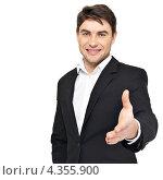 Купить «Мужчина в черном костюме протягивает руку вперед», фото № 4355900, снято 20 февраля 2013 г. (c) Валуа Виталий / Фотобанк Лори