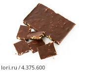 Купить «Шоколад с кусочками фруктов и орехами. Сладкое искушение», фото № 4375600, снято 8 марта 2013 г. (c) Валерия Попова / Фотобанк Лори