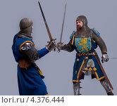 Купить «Сражение двух средневековых рыцарей», фото № 4376444, снято 24 декабря 2011 г. (c) Andrejs Pidjass / Фотобанк Лори