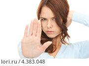 Купить «Девушка с напряженным лицом показывает руками жест стоп», фото № 4383048, снято 11 сентября 2010 г. (c) Syda Productions / Фотобанк Лори