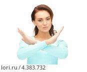 Купить «Девушка с напряженным лицом показывает руками жест стоп», фото № 4383732, снято 22 ноября 2011 г. (c) Syda Productions / Фотобанк Лори