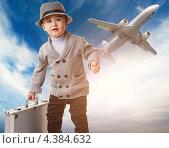 Купить «Мальчик с чемоданом и улетающий самолет», фото № 4384632, снято 18 ноября 2008 г. (c) Andrejs Pidjass / Фотобанк Лори
