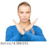 Купить «Молодая женщина с напряженным лицом показывает жест стоп», фото № 4388012, снято 8 мая 2010 г. (c) Syda Productions / Фотобанк Лори