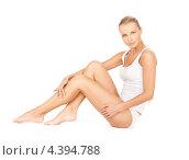 Купить «Красивая молодая женщина в белом хлопковом белье на белом фоне», фото № 4394788, снято 8 мая 2010 г. (c) Syda Productions / Фотобанк Лори