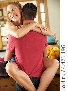 Купить «Романтическая пара обнимается на кухне», фото № 4421196, снято 17 июля 2012 г. (c) Monkey Business Images / Фотобанк Лори