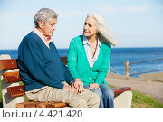 Купить «Пожилая женщина обращается к своему расстроенному мужу на скамейке у моря», фото № 4421420, снято 18 октября 2012 г. (c) Monkey Business Images / Фотобанк Лори