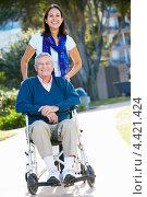 Купить «Дочь возит в инвалидном кресле пожилого отца по парку», фото № 4421424, снято 18 октября 2012 г. (c) Monkey Business Images / Фотобанк Лори