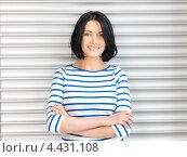 Купить «Очаровательная студентка с темными волосами в голубой тельняшке», фото № 4431108, снято 7 апреля 2012 г. (c) Syda Productions / Фотобанк Лори