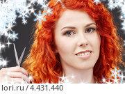 Купить «Рыжая девушка с острыми ножницами на фоне со снежинками», фото № 4431440, снято 3 мая 2008 г. (c) Syda Productions / Фотобанк Лори