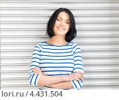 Купить «Очаровательная студентка с темными волосами в голубой тельняшке», фото № 4431504, снято 7 апреля 2012 г. (c) Syda Productions / Фотобанк Лори