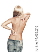 Купить «Блондинка в джинсах на белом фоне», фото № 4433216, снято 11 февраля 2012 г. (c) Дмитрий Эрслер / Фотобанк Лори