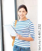 Купить «Счастливая студентка с большим блокнотом в руке», фото № 4461232, снято 31 марта 2012 г. (c) Syda Productions / Фотобанк Лори