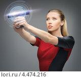 Купить «Молодая деловая женщина работает с виртуальным экраном», фото № 4474216, снято 17 ноября 2012 г. (c) Syda Productions / Фотобанк Лори