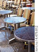Купить «Мокрые от дождя столики французского кафе, Париж», фото № 4479812, снято 24 апреля 2012 г. (c) Елена Поминова / Фотобанк Лори