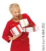 Купить «Соблазнительная молодая женщина с подарками в руках», фото № 4484352, снято 7 октября 2012 г. (c) Syda Productions / Фотобанк Лори