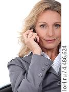 Купить «Деловая женщина средних лет разговаривает по телефону», фото № 4486624, снято 17 июня 2010 г. (c) Phovoir Images / Фотобанк Лори
