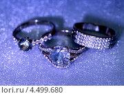 Купить «Золотые ювелирные украшения с бриллиантами на синем фоне», фото № 4499680, снято 2 ноября 2012 г. (c) ElenArt / Фотобанк Лори